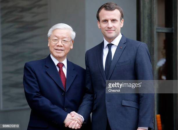 French President Emmanuel Macron welcomes Vietnam's Communist Party General Secretary Nguyen Phu Trong prior to their meeting at the Elysee Palace on...