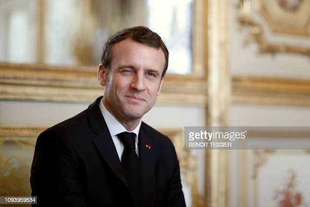 French President Emmanuel Macron winks during a meeting at the Elysee Palace in Paris on February 5 2019