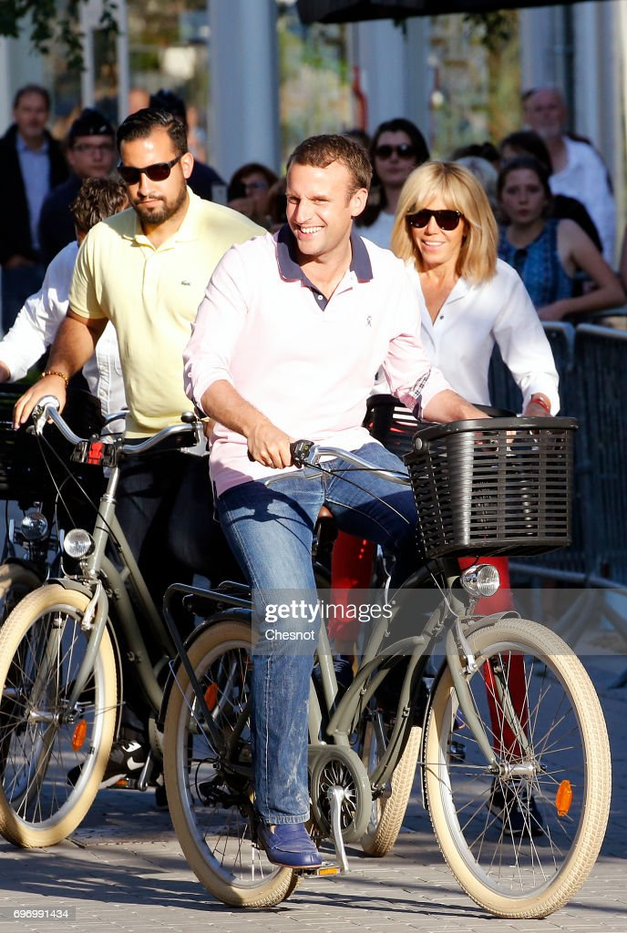 French President Emmanuel Macron with his wife Brigitte Trogneux and with his deputy chief of staff Alexandre Benalla (L) leave their house on a bicycle on the eve of the second round of the French parliamentary elections on June 17, 2017 in Le Touquet-Paris-Plage, France. The second round of the French legislative elections will take place on June 18, 2017.