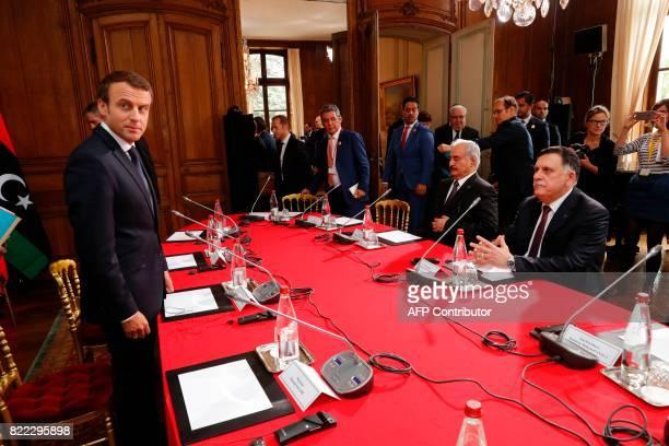 French President Emmanuel Macron , with Libyan Prime Minister Fayez al-Sarraj and General Khalifa Haftar , commander in the Libyan National Army ,...