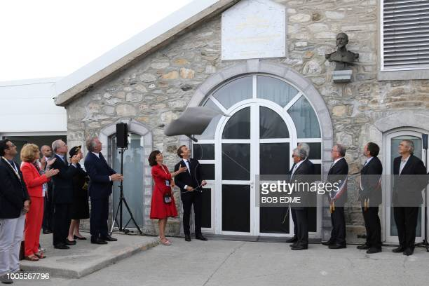 French President Emmanuel, unveils a commemorative plate as part of the inauguration of the new tourist areas at the Pic du Midi observatory in the...