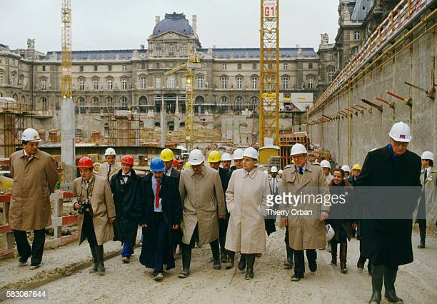 French President Francios Mitterrand tours the construction site of the Louvre Museum's new Pyramid Entrance