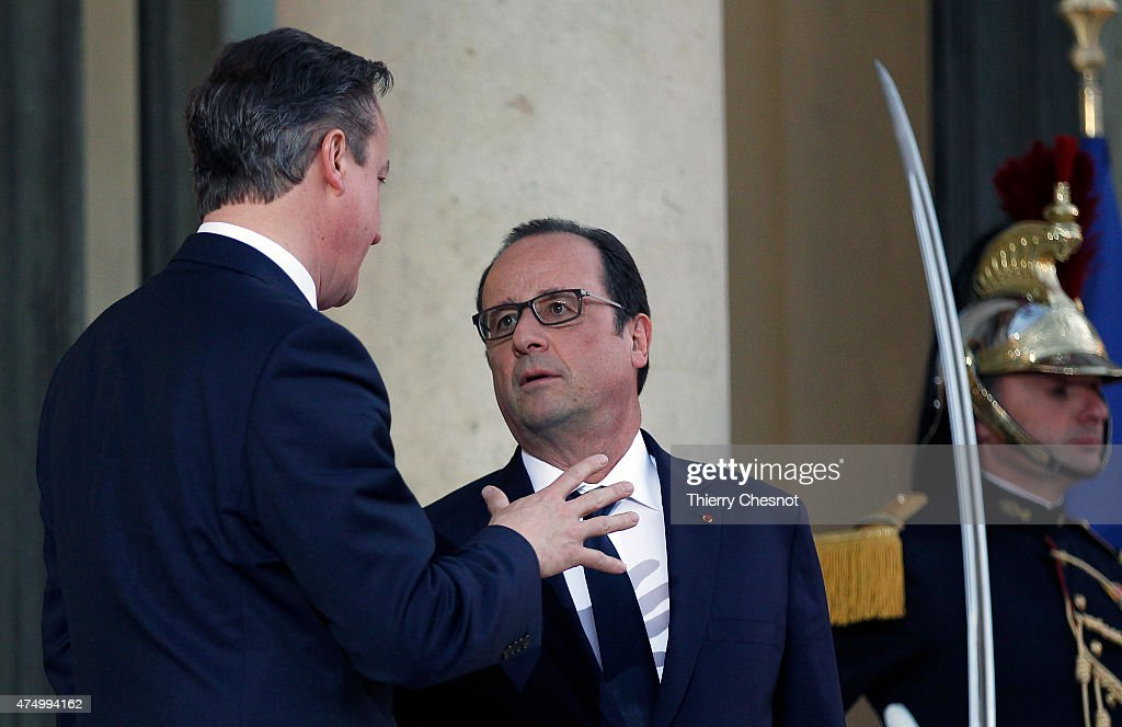 French President Francois Hollande accompanies British Prime Minister David Cameron after their meeting at the Elysee Palace on May 28, 2015 in Paris, France. David Cameron met Francois Hollande to discuss the situation concerning the United Kingdom in the European Union.