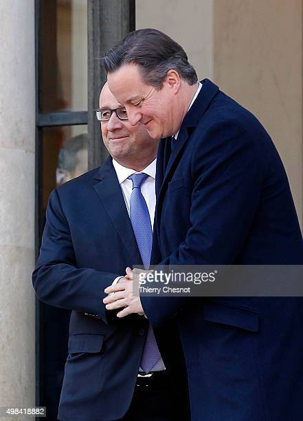 French President Francois Hollande accompanies British Prime Minister David Cameron after their meeting at the Elysee Presidential Palace on November...