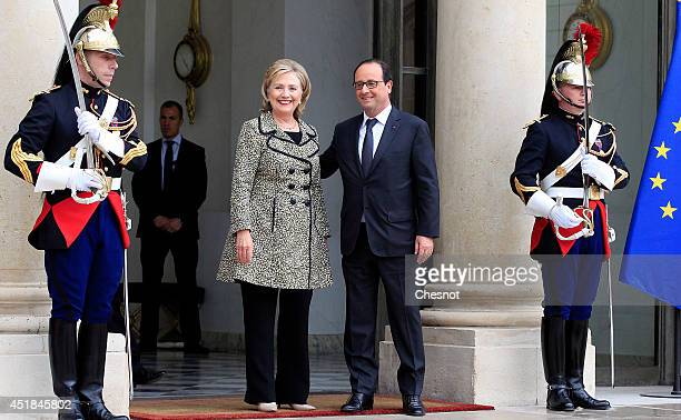 French President Francois Hollande accompanies former US Secretary of State Hillary Clinton after their meeting at the Elysee Palace on July 8 in...