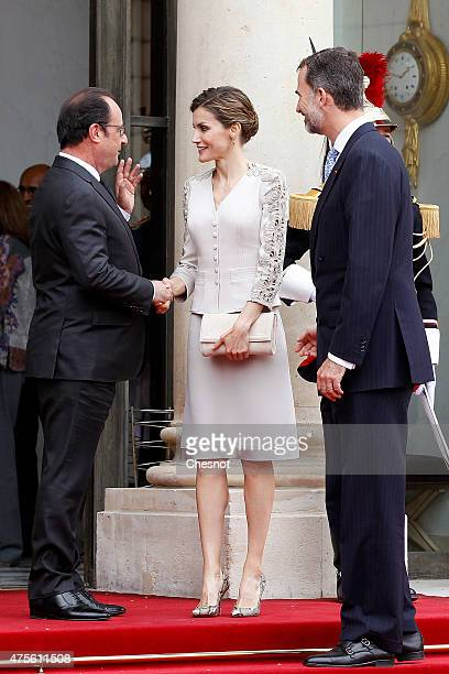 French President Francois Hollande accompanies King Felipe VI of Spain and Queen Letizia of Spain after their meeting at the Elysee Palace on June 2...