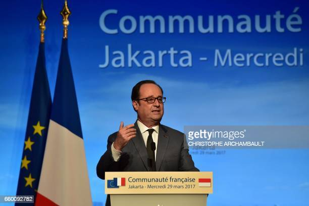 French President Francois Hollande addresses members of the French community in Jakarta on March 29 2017 Hollande is on the last day of his Asian...