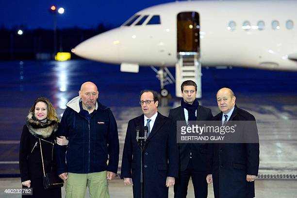 French President Francois Hollande addresses the media as Diane Lazarevic her father Serge Lazarevic France's last remaining hostage Clement Verdon...