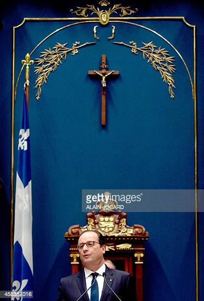 French President Francois Hollande addresses the Quebec National Assembly on November 4 2014 in Quebec Hollande continues his Canadian visit Tuesday...