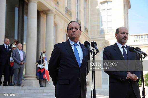 French President Francois Hollande and Ahmad Al-Assi Al-Jarba, Leader Of Syrian National Coalition, speak during a joint press conference after a...
