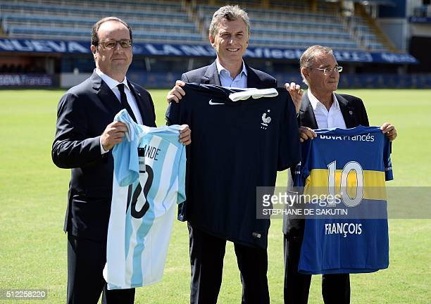 French President Francois Hollande and Argentina's President Mauricio Macri pose with each others national football jerseys and the vicepresident of...