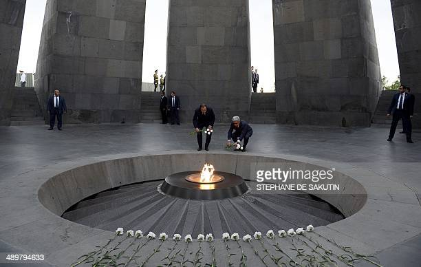 French President Francois Hollande and Armenian President Serzh Sarkisian lay flowers at the genocide memorial which commemorates the 1915 mass...