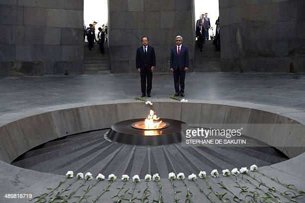 French President Francois Hollande and Armenian President Serzh Sarkisian pay tribute at the genocide memorial which commemorates the 1915 mass...