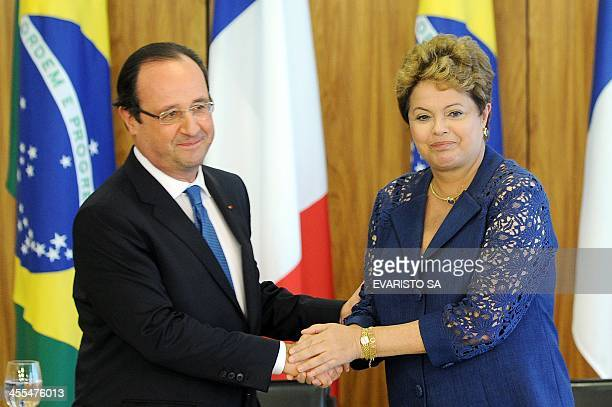 French President Francois Hollande and Brazilian President Dilma Rousseff shake hands after a signing agreements at Planalto Palace in Brasilia on...