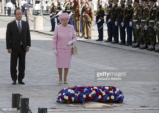 French President Francois Hollande and Britain's Queen Elizabeth II pay their respects after laying a wreath on the Tomb of the Unknown Soldier at...