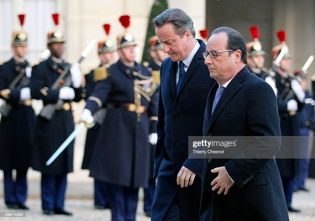 French President Francois Hollande and British Prime Minister David Cameron arrive to attend a meeting at the Elysee Presidential Palace on November 23, 2015 in Paris, France. The meeting comes over a week after the Paris terrorist attacks that claimed at least 129 lives in the French capital.