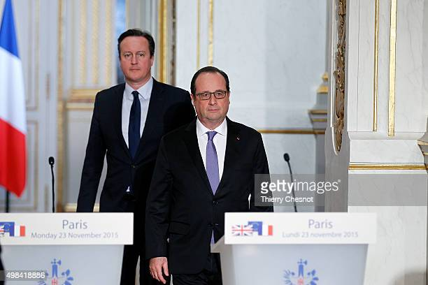 French President Francois Hollande and British Prime Minister David Cameron arrive to attend a joint statement at the Elysee Palace on November 23...