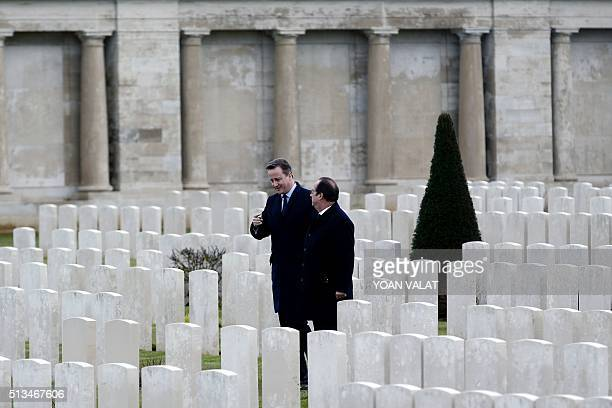 French President Francois Hollande and British Prime Minister David Cameron speak as they pay their respects at the Pozieres British Memorial during...