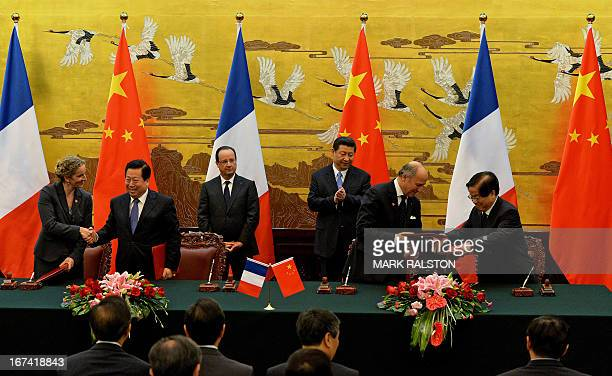 French President Francois Hollande and Chinese President Xi Jinping look on during a signing ceremony between France and China at the Great Hall of...