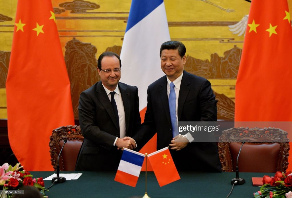 French President Francois Hollande (L) and Chinese President Xi Jinping shake hands during a signing ceremony at the Great Hall of the People on April 25, 2013 in Beijing, China. Hollande has begun a two day trade visit to China bringing with him a large French trade delegation.