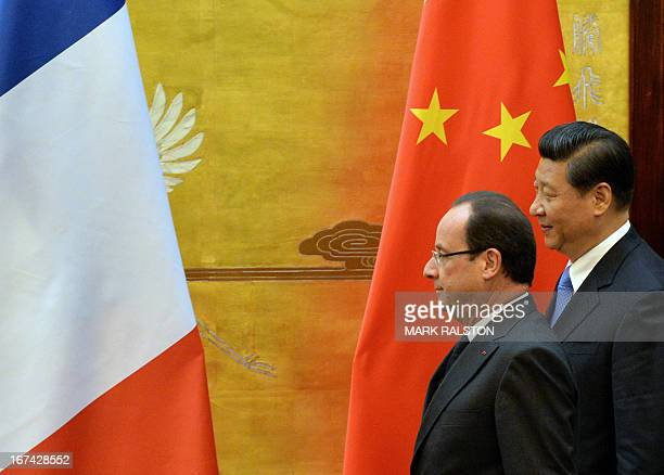 French President Francois Hollande and Chinese President Xi Jinping arrive for a joint declaration ceremony at the Great Hall of the People in...