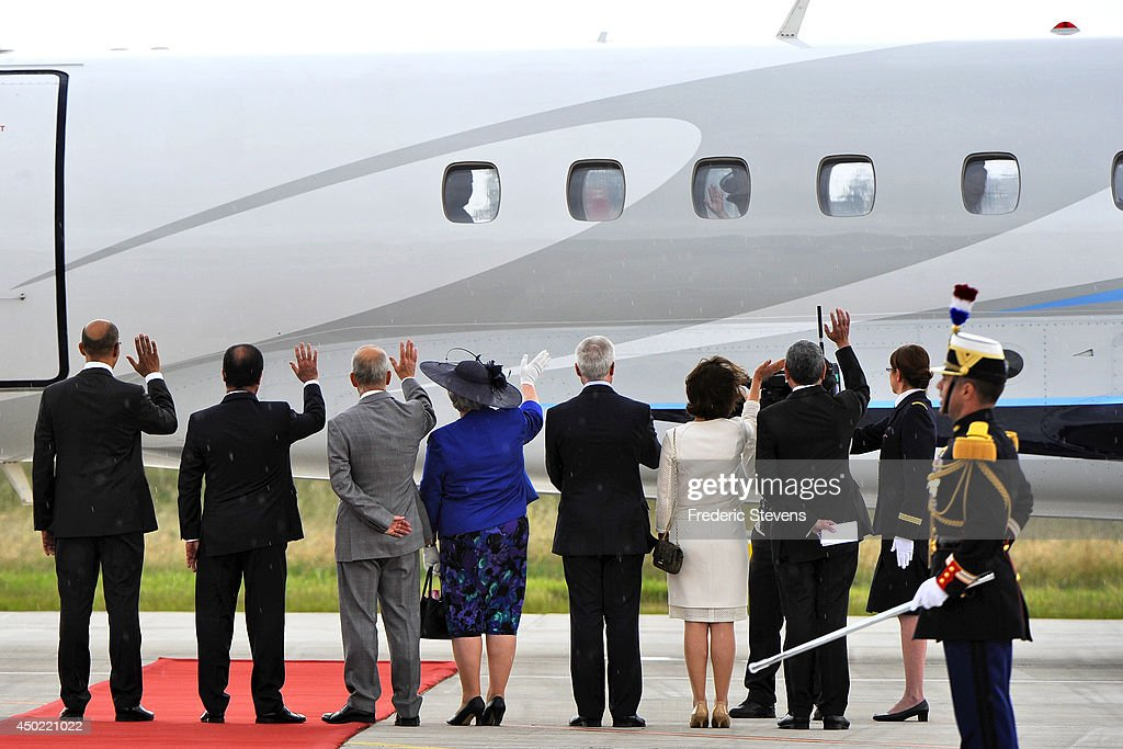 French President Francois Hollande (2nd left) and dignitaries wave goodbye to Queen Elizabeth II as she leaves following a departure ceremony at the Villacoublay airport on June 7, 2014 in Paris, France. The Queen is on the final day of a three day State Visit to Paris.