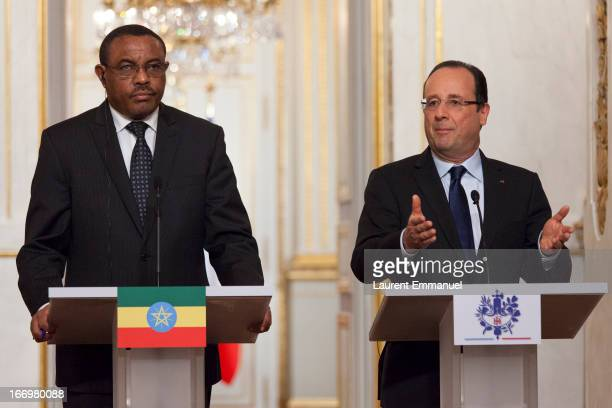 French President Francois Hollande and Ethiopian Prime Minister Hailemariam Desalegn address reporters during a press conference following their...