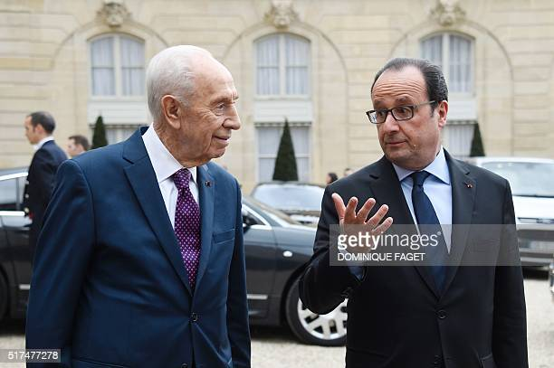 French President Francois Hollande and former Israeli President Shimon Peres talk to the press after their meeting at the Elysee Palace in Paris, on...