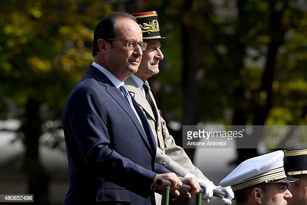 French President Francois Hollande and French Army Chief General Pierre de Villiers parade in a command car during the annual Bastille Day military...