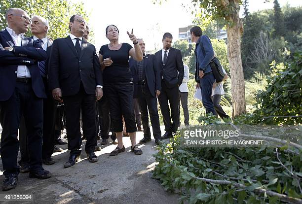 French President Francois Hollande and French President of the general council for the AlpesMaritimes Eric Ciotti meet victims of a flood disaster in...