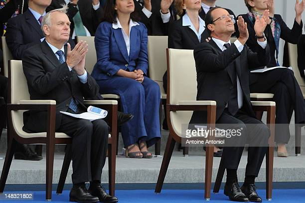 French President Francois Hollande and French Prime Minister Jean Marc Ayrault attends the Bastille Day Military Ceremony on July 14 2012 in Paris...