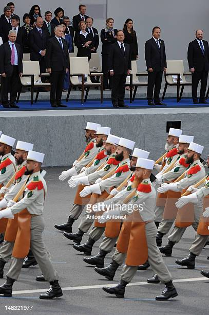 French President Francois Hollande and French Prime Minister Jean Marc Ayrault look on as soldiers from the French Foreign Legion take part in the...