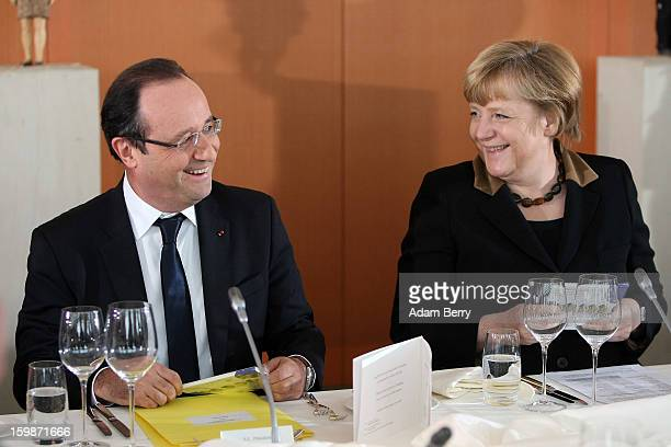 French President Francois Hollande and German Chancellor Angela Merkel arrive for a joint council meeting at the German federal chancellery during...