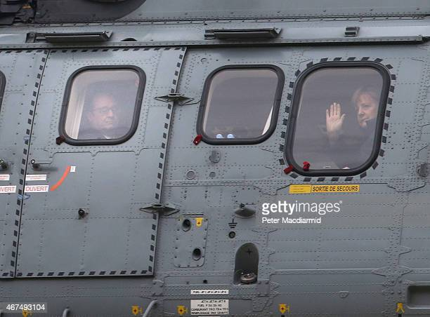 French President Francois Hollande and German Chancellor Angela Merkel leave in a helicopter after meeting with rescue workers on March 25 2015 in...