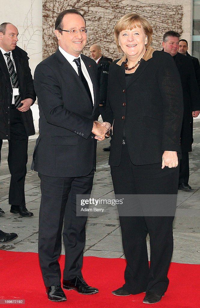 French President Francois Hollande (l.) and German Chancellor Angela Merkel greet each other prior to a joint council meeting at the German federal chancellery during the 50th anniversary celebration of the Elysee Treaty on January 22, 2013 in Berlin, Germany. The treaty, concluded in 1963 by Charles de Gaulle and Konrad Adenauer in the Elysee Palace in Paris, set a new tone of reconciliation between France and Germany, and called for consultations between the two countries to come to a common stance on policies affecting the most important partners in Europe as well as the rest of the region. Since its establishment, the document for improved bilateral relations has been seen by many as the driving force behind European integration.