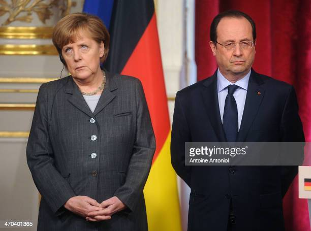 French President Francois Hollande and German Chancellor Angela Merkel pose during a joint press conference on February 19 2014 in Paris France...