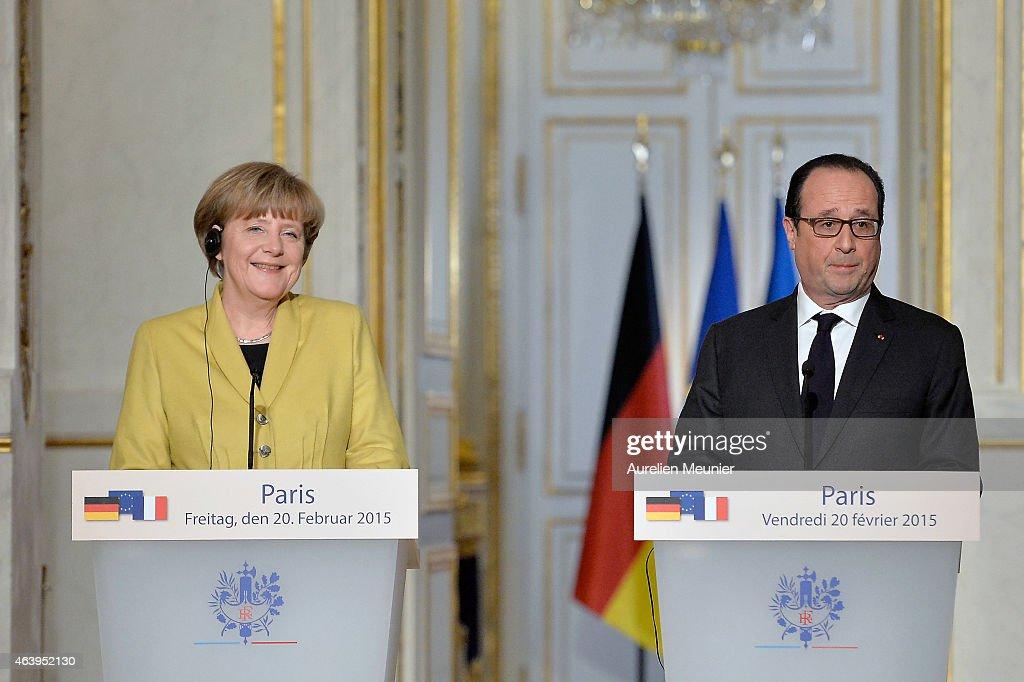French President Francois Hollande Receives German Chancellor Angela Merkel At Elysee Palace
