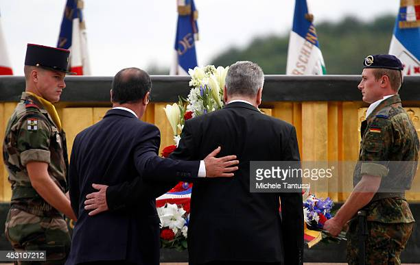 French President Francois Hollande and German President Joachim Gauck attend a ceremony at the memorial to the battles at Hartmannswillerkopf as part...