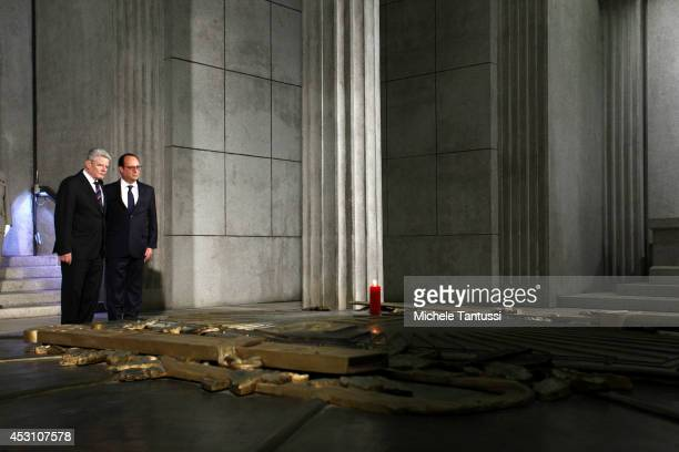 French President Francois Hollande and German President Joachim Gauck visit the crypt at the memorial to the battles at Hartmannswillerkopf as part...