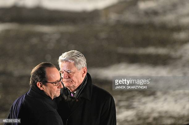 French President Francois Hollande and German President Joachim Gauck embrace eachother after the main ceremony to mark the 70th anniversary of the...