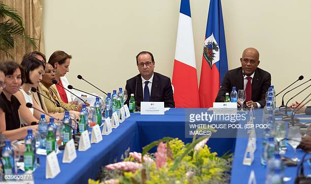 French President Francois Hollande and Haitian President Michel Martelly meet at the presidential palace on May 12 2015 in PortauPrince AFP PHOTO /...