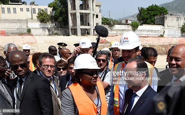 French President Francois Hollande and Haitian president Michel Martelly visit the site of the of the Haiti State University hospital on May 12 2015...