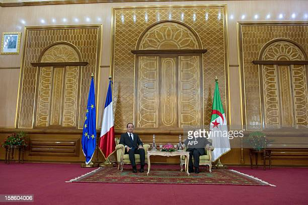 French President Francois Hollande and his Algerian counterpart Abdelaziz Bouteflika sit at the univeristy in Tlemcen on the second day of Hollande's...