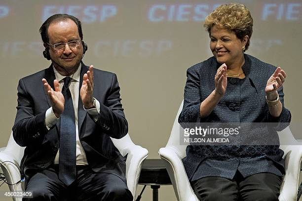French President Francois Hollande and his Brazilian counterpart Dilma Rousseff attend a meeting with businessmen at the Sao Paulo State Industry...