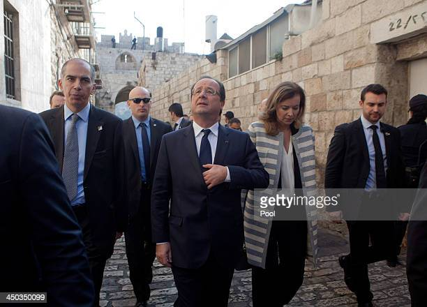 French President Francois Hollande and his companion Valeria Trierweiler visit the Saint Anna Church in the Old CIty of Jerusalem on November 18 2013...