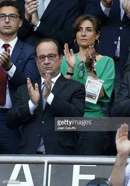 French President Francois Hollande and his sports adviser Nathalie Iannetta attend the Top 14 Final between ASM Clermont Auvergne and Stade Francais...