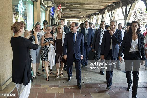 French President Francois Hollande and JeanPierre Bel the President of the French Senate tour the Mirepoix center in Andorra La Vella on June 2014 as...