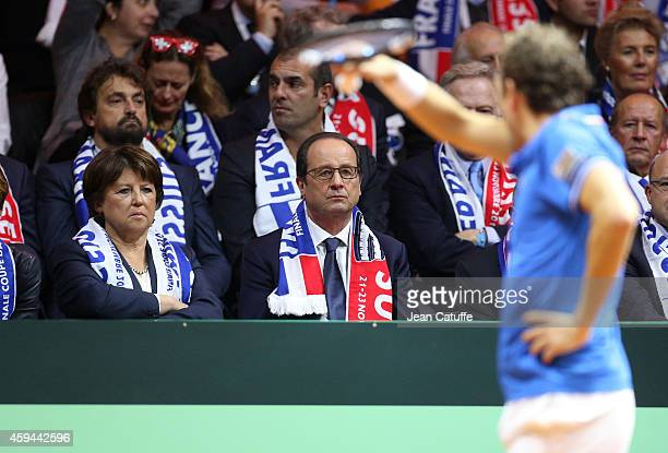French President Francois Hollande and Mayor of Lille Martine Aubry attend the doubles on day two of the Davis Cup tennis final between France and...