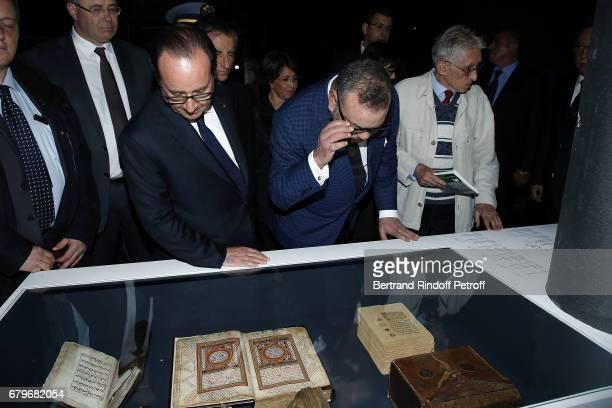 French President Francois Hollande and Morocco's King Mohammed VI visit 'Tresor de l'Islam en Afrique' at Institut du Monde Arabe on May 6 2017 in...