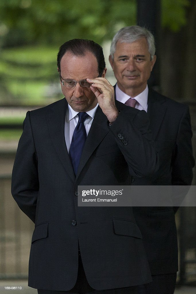French President Francois Hollande (L) and President of the French National Assembly Claude Bartolone attend a ceremony marking the abolition of slavery in the Jardins du Luxembourg on May 10, 2013 in Paris, France. Taubira Law was passed in May 2001 acknowledging slavery and the Atlantic slave trade as crimes against humanity.